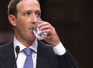 Facebook CEO, Mark Zuckerberg drinking water at the house hearing